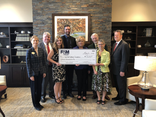 Bank staff presents check to SpiriTrust officials