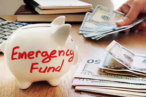 piggy bank with emergency funds written on it