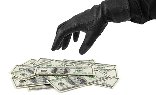 hand stealing money